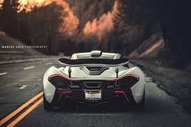 stunning white mclaren p1 rear view on the road - SSsupersports
