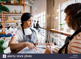 Hostess Discussing Seating Chart Stock Photo 259730207 Alamy