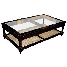 anglo indian style ebonized wood glass and cane coffee table at