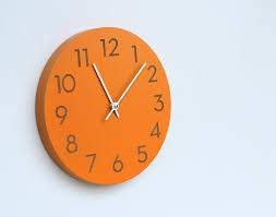 orange spice wall clock via