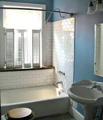old bathroom remodel. original bathroom had toilet and sink on opposite walls. window in shower. rearranging a old remodel t