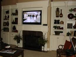 image of tv above the fireplace where to put the cable box size