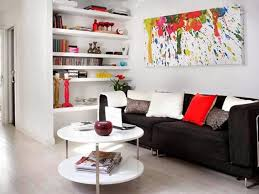 Black and white decorating with red color accents, small living room design