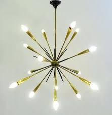 modern glamour a groovy classic with our own ly twist the sputnik chandelier is perfect for making your pad feel like a parisian parlour our