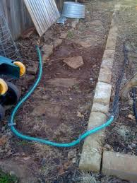 part a i had my new pal johnny on the spot put a faucet in next to the vegetable bed so i could run a short length of water hose to the soaker