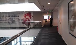 hitachi consulting logo. entry way from elevator by atrium - hitachi consulting dallas, tx logo a