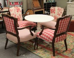 french country upholstered chairs and round white table sold