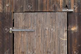 hinged barn doors. Detail Of A An Old Weathered Wooden Barn Door With Metal Hinge Stock Photo - 62461960 Hinged Doors
