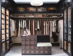 Walk in closet systems Small Space Light Brown Walk In Closet With Dark Brown Fronting Closet Rods Shelves And Lighted Display Cabinets Closet Concepts Walk In Closets Designs Ideas By California Closets