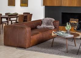 living room set up with cigar rawhide brown sofa
