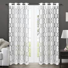 exclusive home curtains rio burnout sheer grommet top window curtain panel pair winter white 54x84