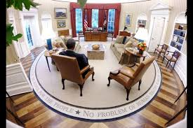 president barack obama reads material before the presidential daily briefing in the oval office on aug barack obama enters oval