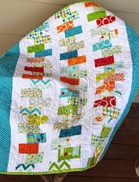 Girls in the Garden: Quilts for Boys & Baby boy quilt made with blues and reds and greens from a charm pack Adamdwight.com