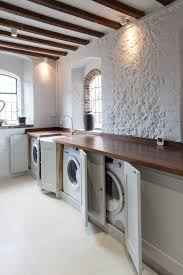 these cabinets are made from solid oak and feature painted in frame doors on traditional hinges the worktop is walnut a similar utility room by