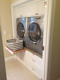 Amazing Built In Laundry Cabinets Stacked Washer And Dryer Design ...
