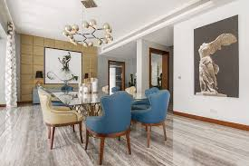 view in gallery exclusive dining area with brilliant wall art and custom lighting fixtures