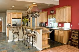 An Eclectic Kitchen With Light Wood Cabinets Without Pulls And Tile Floors  In A Dusky Blue Design Ideas