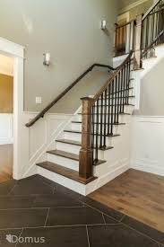 Staircase with white accents and black metal spindles