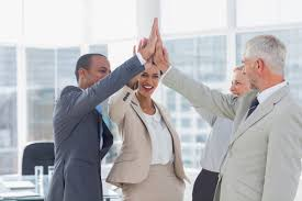a group of happy team members high five in the office building home office awful