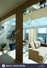 Living Room Extension Mirrored Pillar In Modern Glass Living Room Extension With Beige