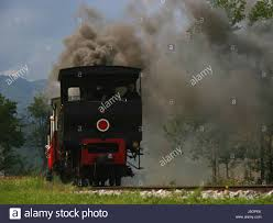 smoke smoking smokes fume railway locomotive train engine rolling ...