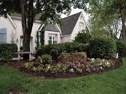 front yard flower bed with bench and stone from proactive grounds green outdoor lighting area lighting flower bed