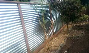installing a corrugated metal fence