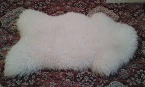 cream sheepskin rug