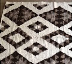 black and white diamond rug. diamond patterned black and white handmade fair trade guatemalan rug by meso - shop nectar d