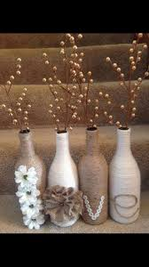 Twine and yarn wrapped wine bottles for a great rustic set. DIY by Hercio  Dias