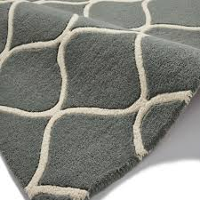 duo tone quatrefoil wool rug tufted by hand in greyish blue and cream awesome quatrefoil rug uk