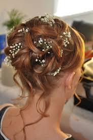 Bruidskapsel Met Lussen En Losse Plukjes Met Gipskruid Als Haar