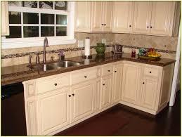 Tropic Brown Granite Countertops With White Cabinets Design In