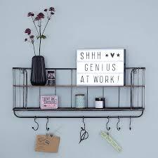 two shelf metal wall unit with hooks