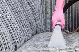 cleaning furniture with an upholstery