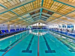 Indoor olympic swimming pool Athletic Swimming Pool Complex Offers An Olympicsize Indoor And Outdoor Pool Along With Child Wading Pool And Changing Rooms For Further Enjoyment And Omaha Worldherald Ocean Edge Amenities On Cape Cod Leighton Rentals