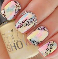 colorful leopard nail art design the background of the nail art is done in a