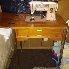 Old Singer Sewing Machine With Cabinet