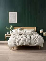 Dark Green Bedroom Wall With Blonde Timber Furniture And Linen House Bedding