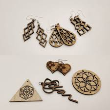 make a wooden pendant for a necklace or other use or pair of earrings using laser cut geometric shapes or letters engrave them with your name and a