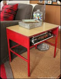 vintage school desk used as a side table very cool