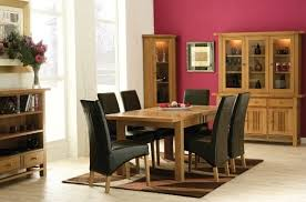 oak dining room table and chair with black slipcovers