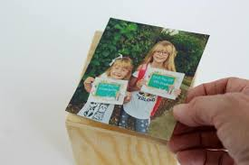 stick the photos on each side of the diy photo cube