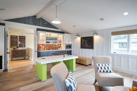 kitchen room pull table: glamorous pool table ping pong combo in family room transitional with snack bar next to built in microwave alongside mini kitchen