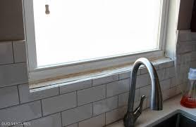 tile around bathroom window sill round designs