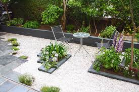 garden timber walls. grey painted walls and bed in modern city rental garden timber