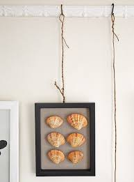 how to hang artwork without nails
