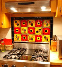 decorative yellow and red glass tile backsplash