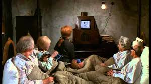 my alternative theory to willy wonka and the chocolate factory  in this scene after 2 failed attempts to golden tickets on both charlies birthday and buying a bar the tobacco money joe and the other family