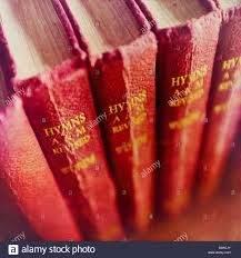 a close up of some old worn hymn books